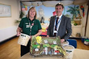 Dave Ayers, head teacher at River Beach Primary School, accepts the hamper for year-six pupils from Alison Whitburn, Morrisons Littlehampton community champion