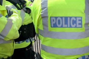 A man has been arrested on suspicion of assault after a woman was injured in a collision in Victoria Street in Warwick.