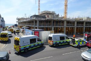 Immigration officers and the police are outside the Bayside Apartments construction site in Brighton Road, Worthing