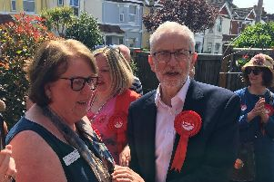 Jeremy Corbyn congratulates and thanks Pat Schan for her 45 years of service as a nurse and midwife for the NHS