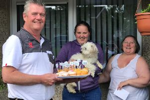 Alan Hynes from Rectory CAG with Tanya Thompson on the right and her daughter Julie in the middle