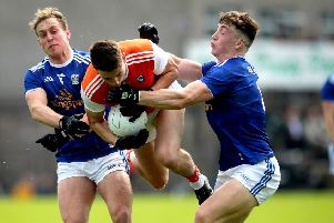 Armagh's Niall Grimley with Padraig Faulkner and Conor Brady of Cavan