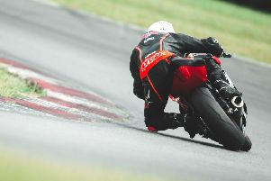 Nick Whitcher leans in to a left-hand corner. Picture courtesy Mitch DuCran Photography