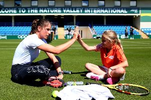 EASTBOURNE, ENGLAND - JUNE 21: Johanna Konta of Great Britain has a surprise hit on court with tennis for kids Ruby prior to the Nature Valley International at Devonshire Park on June 21, 2019 in Eastbourne, United Kingdom. (Photo by Charlie Crowhurst/Getty Images for LTA) *** Local Caption *** Johanna Konta SUS-190622-093409001