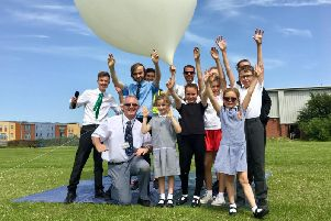 Two students and a teacher from Chatsmore Catholic High School in Goring Street, Worthing, have sent cameras into space
