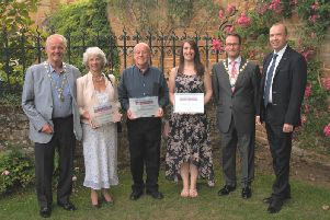 Representatives from Daventry Museum with dignitaries at the Northamptonshire Heritage Forum Awards.