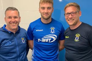 Dungannon Swifts Chairman, Keith Boyd and Manager, Kris Lindsay pictured with new signing, Dylan King