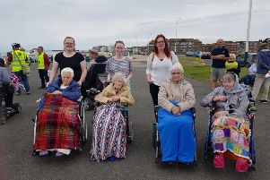 Staff and residents of Abbey House taking part in Bexhill Wheel and Walk