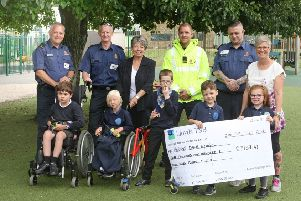 HM Coastguard Shoreham presents a cheque to Herons Dale Primary School for the all terrain wheelchair, supported by Jane Self from Nicosy. Picture: Derek Martin DM1971539a