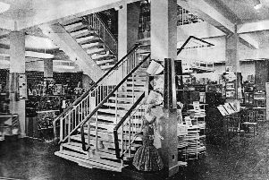 Knight & Lee on the reopening day in 1956. Note the waistline on the mannequin on the right of the stairs.