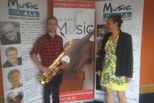 Austin with his teacher Kate, from West Sussex Music