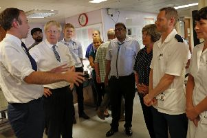 Prime Minister Boris Johnson (second left) and Matt Hancock, Secretary of State for Health and Social Care (left)  meet staff during a visit to Pilgrim Hospital in Boston, to announce the government's NHS spending pledge of 1.8 billion. Picture: Darren Staples/PA Wire