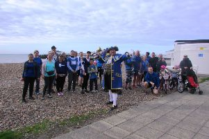 Worthing town crier Bob Smytherman with runners at Miles for Meso SUS-170310-084216003