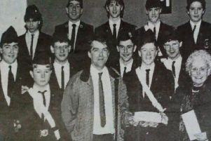 Tom McDowell and Margaret McCartney receive a cheque on behalf of the Tower House Fund from members of Second Ballymena BB. Making the presentation is Lee Eagleson.'1989