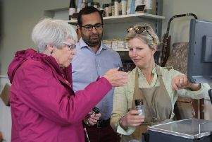Navneet and Lindsay Singh with shopper Helen Labraham.