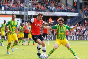 James Collins holds the ball up against West Bromwich Albion