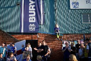 Bury fans stood outside Gigg Lane yesterday. Picture: Christopher Furlong/Getty Images