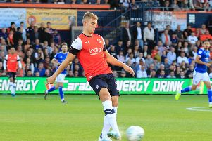 Defender James Breen in action for the Hatters