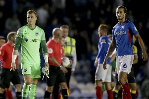 Craig MacGillivray and Christian Burgess dejected after Pompey's draw with Coventry. Picture: Robin Jones