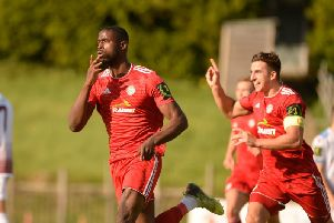 Substitute Shola Ayoola celebrates his late leveller at Hastings United. Picture by Marcus Hoare