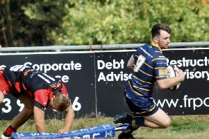 Sam Boyland forces his way over against Old Redcliffians. Picture by Stephen Goodger