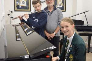 Kai and  Rhianna with  Grahame, their GCSE music tutor.