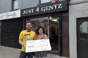 Michael Martin from Banbridge presenting Lesley Wright from AWARE with a cheque following his recent walk