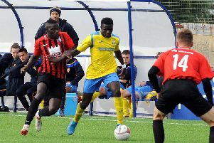 Lancing's Mo Juwara in action against AFC Uckfield on Saturday. Photo by Kate Shemilt
