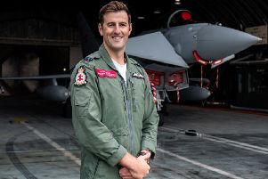 Flight Lieutenant Mathew Stannard in front of a 41 Test and Evaluation Squadron Typhoon in a Hardened Aircraft Shelter at 3 (Fighter) Squadron at RAF Coningsby.