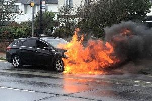 The car was engulfed in flames in Worthing