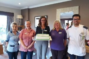 Ionela Lazar, senior nurse, Sophie Cox, head housekeeper, Karen Howell, general manager, Theresa Holland, activities assistant and Cristain Constantinescu, senior nurse SUS-191016-162749001