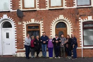 The Thibodeau family find their mother's old house in Belfast