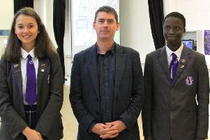 Journalist Peter Foster with students at Worthing High School