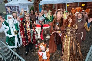 The Wick Village Medieval Frost Fair at Wickmas 2018. The then-Mayor of Littlehampton, Councillor Billy Blanchard-Cooper,  Julie Roby, Wick Information Centre and Wick Hall manager, and volunteers pose for a photo with two of the donkeys that attended the event.
