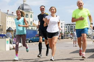 Worthing runner Clare Rixon, front, with, from left, Martine Rossiter, Michael Rix and Hilary Spicer. Photo by Derek Martin DM17735585a
