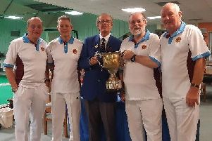 Victory Indoor Bowls skip Adrian Ash receiving the cup on behalf of his team for winning the Home Counties Fours from John Kellow, Hon. Fixtures Secretary of the Hampshire Indoor Bowls Association. From left - Tom Pullin,  Mick Leeson, John Kellow, Adrian Ash and Terry Smith.