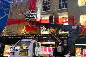 Alan Harwood, owner of Property Maintenance Sussex, repairing the ginormous Christmas decoration