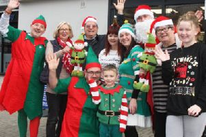 DM19121286a.jpg. Sudz Cleaners, Lancing are dressing up as elves for dementia awareness day. Photo by Derek Martin Photography. SUS-190712-191545008