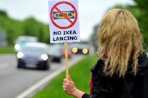 A resident protests against plans for IKEA