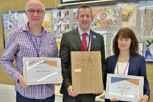 Head teacher Simon Liley presents the Oliver Rumbol Perpetual Award to Shirley Rumbol, Oli's mother, and John Gregory, Olivia's father