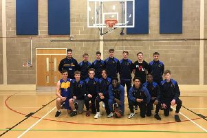 Collyers mens basketball team line-up after their south east regional tournament success.