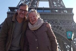 Rose Southon, who lives at Care UK's Skylark House in Horsham, visiting the Eiffel Tower in Paris with her son Nick SUS-181219-141315001