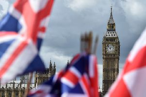National flags flutter near the The Elizabeth Tower, commonly referred to as Big Ben, in central London 700062492