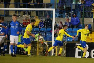 Paul McElroy wheels away following his penalty kick to break the deadlock in Dungannon Swifts' Irish Cup tie with Glenavon. Pic by Pacemaker.