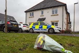 Flowers left on Fleming Court in the Shevington area of Wigan, following the arrest of a 32-year-old man on suspicion of murder a baby girl died. Picture: Peter Byrne/PA Wire