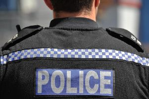 A man attacked an elderly woman and stole her shopping trolley in Crawley