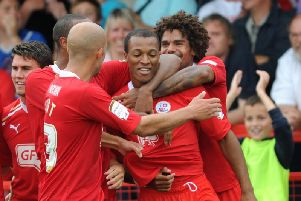 Crawley players celebrate Wes Thomas' goal against Macclesfield (Pic by Jon Rigby)