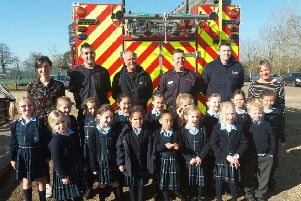 The firefighters join staff and pupils at Farlington
