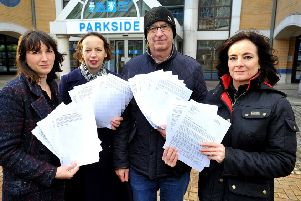 Lucy Holloway, who started the petition with two other mums, pictured with Labour members Carol Hayton,  Michael and Karen Symes outside council offices with the petition, which called for weekly food waste collections