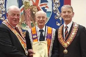 Robbie Miller (centre) with Orange Order Grand Master Edward Stevenson (left) and north west Orangeman Maurice Devenney